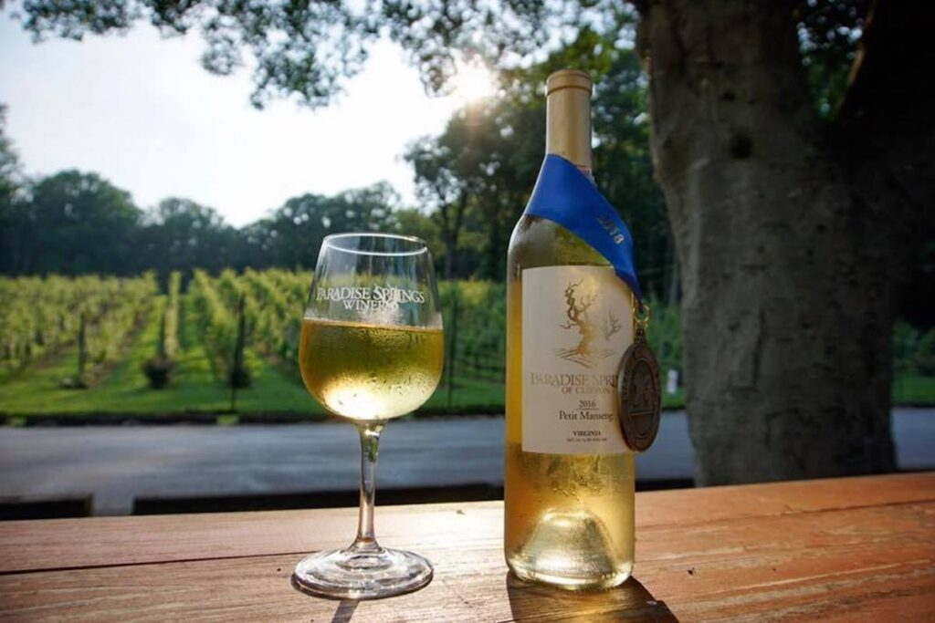 Bottle and glass of award-winning wine at Paradise Springs Winery